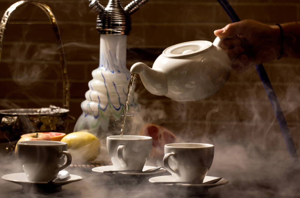 Hookah and tea stand in the cafe on the table
