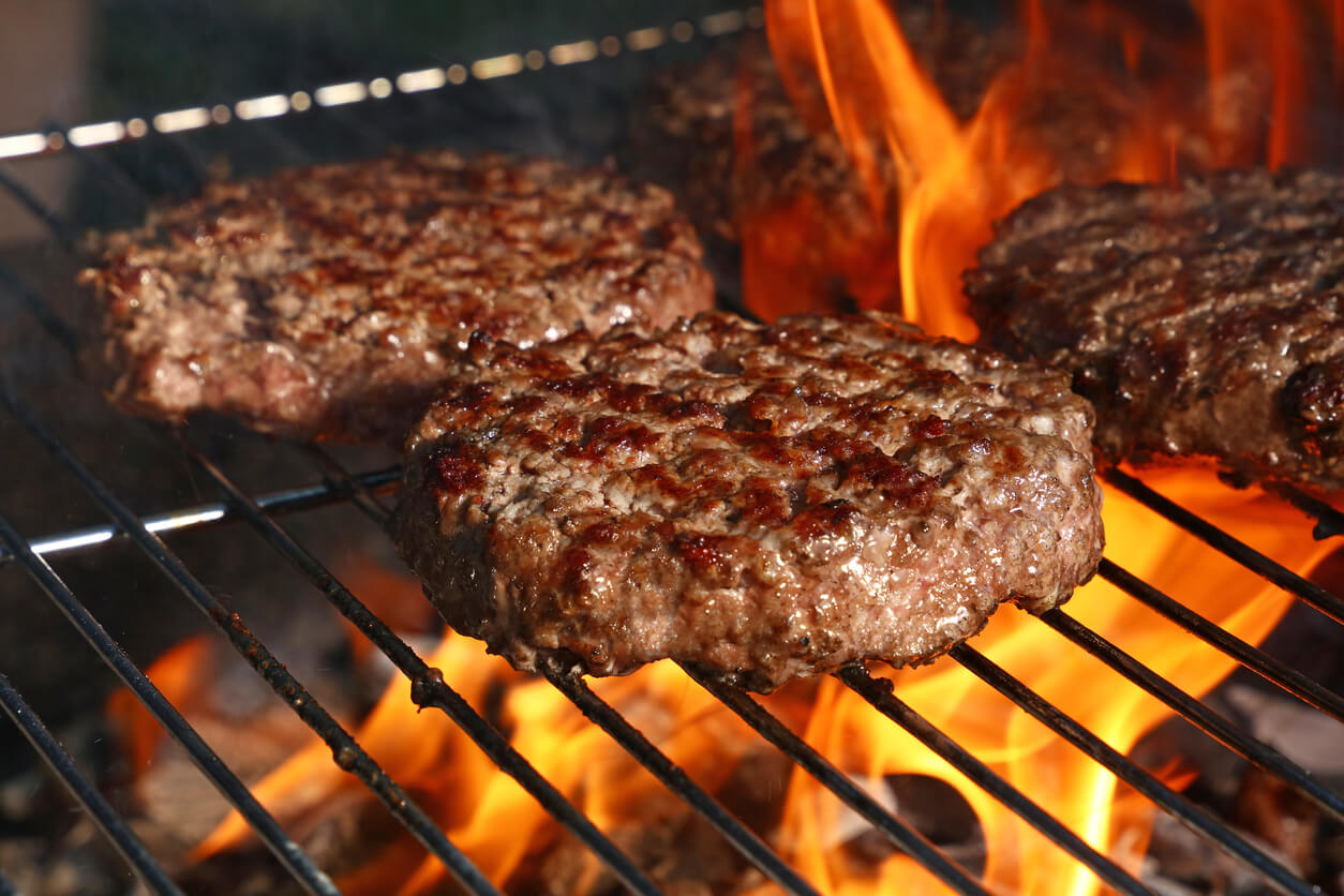 Hamburger Prepared Grilled On Bbq Fire Flame Grill
